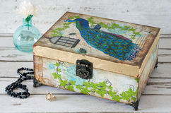 Peacock Box. A jewellery box decoupaged with a Peacock and gilded with gold leaf Royalty Free Stock Image