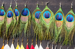 Peacock feather earrings Stock Photo