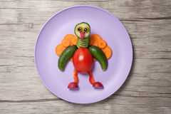 Peacock made of raw vegetables on plate Stock Images