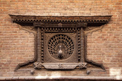 Peacock window, Nepal. The famous 9th century peacock carved window in Bhaktapur, Nepal Royalty Free Stock Images