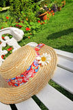 Peacuful summer garden with a hat Royalty Free Stock Photo