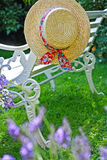 Peacuful summer garden with a hat Stock Photo