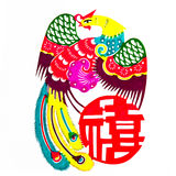 Peafowl meet the good luck to. This is a Chinese paper-cut picture. pictures reflect happiness, good fortune, tied the knot meaning. Paper-cut is one of the Royalty Free Stock Image