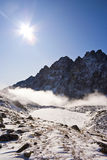 Peak above the fog Royalty Free Stock Photos