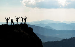 Team on mountain top & Successful people