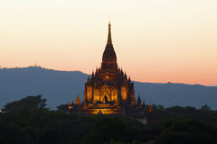 The peak of the ancient Buddhist temple of Gawdaw Palin at sunset. Bagan, Myanmar Stock Photography