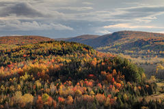 Peak Autumn Sunrise. Peak autumn colors in the mountains of the eastern townships at sunrise, Quebec Canada stock image
