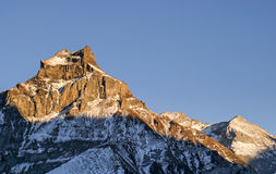 Peak. Beautiful light hitting the top of Mount Hannen at the end of day, Engelberg, Switzerland stock photo