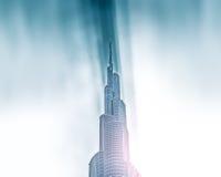 Peak of Burj Khalifa in sunbeams in Dubai, UAE. Stock Images