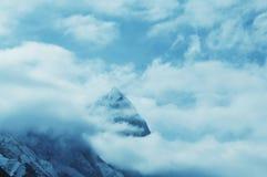 Peak in clouds Royalty Free Stock Image