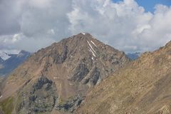 Peak and clouds. Beautiful mountains peak, clouds, highlands Royalty Free Stock Image