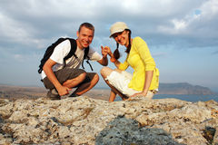 Peak is conquered!. Happy guy and girl on the peak of a mountain Stock Photos