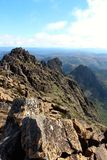On the peak of Cradle Mountain. On the top of Cradle Mountain in the stunning national park in Tasmania stock images