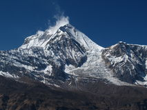 Peak of Dhaulagiri and Ice-Fall. Seventh highest mountain in the world stock photo