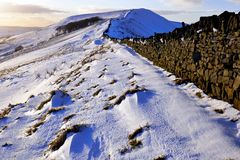 Rushup Edge, Derbyshire, UK. Peak district, Derbyshire, UK, February 12, 2018. A dry stone wall runnining along the ridge of Rushup Edge leading to Lord`s seat Royalty Free Stock Photo