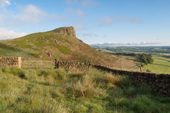 Peak district landscape. Of the roaches in Staffordshire UK showing gate footpath and hill in distance sunshine Royalty Free Stock Images