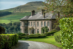 Peak District Mansion. Crag Hall in the village of wildboarclough with Shutlingsloe peak in the background Stock Images