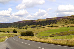 Peak District National Park in Derbyshire. A country road through the Peak District National Park in Derbyshire Royalty Free Stock Photo