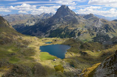 Peak du Midi d'Ossau and the lake Gentau in the Atlantic Pyrenees Stock Image