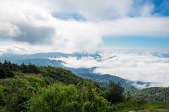 Peak green mountain white fog cloud scenic Royalty Free Stock Image