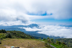 Peak green mountain white fog cloud scenic Royalty Free Stock Images