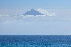 Peak of holy mountain Athos above the clouds Royalty Free Stock Photo