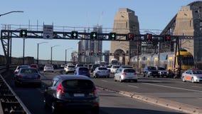 Sydney, Australia - October 18, 2019 - Rush hour traffice heading over the Sydney Harbour Bridge on a sunny blue sky stock video