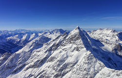 Peak in Jungfrau region helicopter view in winter Stock Photo
