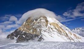 Peak Khan Tengri (7010 m). Big snowy mountain Khan Tengri top covered by cloud Stock Photos