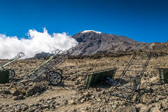 Peak of Kilimanjaro with emergency carts Royalty Free Stock Photos