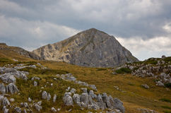 Peak in the Majella massif. Mountain peak in the Majella massif, Abruzzo region, rocks surfacing in the forefront, geological stratification visible Royalty Free Stock Images