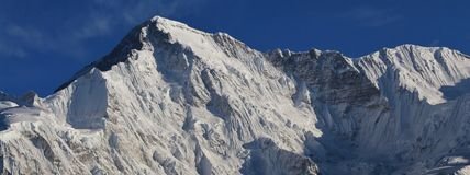 Snow covered peak of mount Cho Oyu, Nepal. View from Gokyo, Mount Everest National Park, Nepal. royalty free stock image