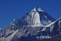 Peak of mount Dhaulagiri. High mountain Dhaulagiri, Nepal. View from a place near Muktinath stock photo