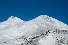 Peak of Mount Elbrus. Double peak of Mount Elbrus in the sunny weather royalty free stock photo