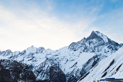 Peak of Mount Machapuchare or popularly known as Fish Tail with the Annapurna base camp beneath.  Royalty Free Stock Image