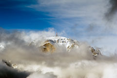 Peak mountain. Communication technology on mountain peak, with blue sky and clouds Royalty Free Stock Photography