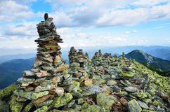 Peak of mountain with moraine and stone landmarks. Stock Photography