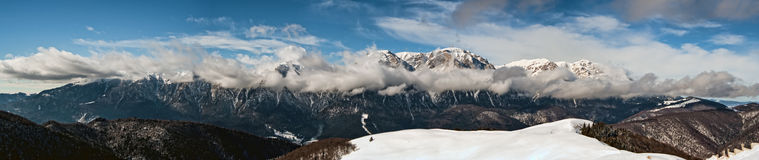 Peak mountain panorama. Panoramic view, communication technology on mountain peak, with blue sky and clouds Stock Photography