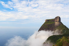Peak Mountain Pedra da Gavea in clouds sky sea ocean, Rio de Jan. Eiro, Brazil. Copy space Royalty Free Stock Image