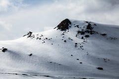 Peak of mountain on winter and ski trace Stock Photo