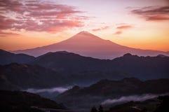 The peak of Mt. Fuji at sunrise in Shizuoka, Japan.  stock images