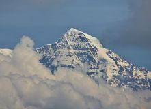 Peak of Mt Monch reaching out of clouds Royalty Free Stock Image