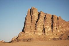 Peak named Seven Pillars of Wisdom, Jordan. Seven Pillars of Wisdom - beautiful rock formation on entry in Wadi Rum Stock Photo