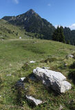 Peak next to Tremalzo mountain in Italy. With boulder in foreground Stock Photography