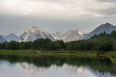 Peak reflections. Stormy weather giving a dramatic look on  Grand Teton Mountains with a reflection in Snake River Royalty Free Stock Photos