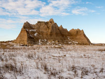 A Peak Rises in the Badlands Stock Photo