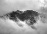 Rocky mountain in clouds Stock Image