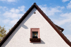 Peak roof and a window Stock Images