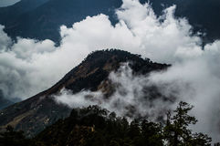 Peak Shrouded in Clouds Along the Everest Base Camp Trek in the Nepalese Himalayas Royalty Free Stock Images