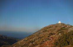 Peak of Stroumpoulas. Stroumpoulas is an almost pyramid shaped peak, near Heraklion, Crete. On the peak a church was built, above remnants of German WW II Royalty Free Stock Photos